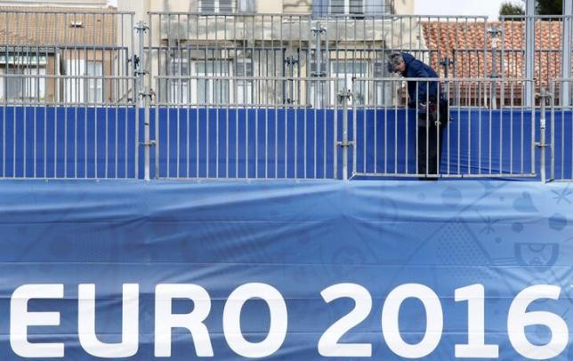 A worker installs safety barriers at a fan zone before the start of the UEFA 2016 European Championship in Marseille