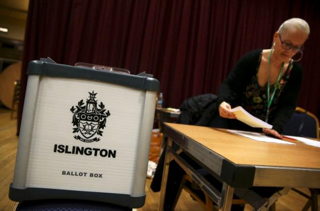 An electoral worker prepares up a polling station for the Referendum on the European Union in north London