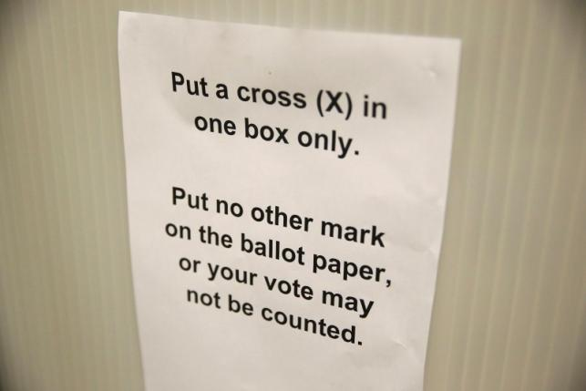 A sign gives voting instructions in a voting booth at a polling station for the Referendum on the European Union in north London