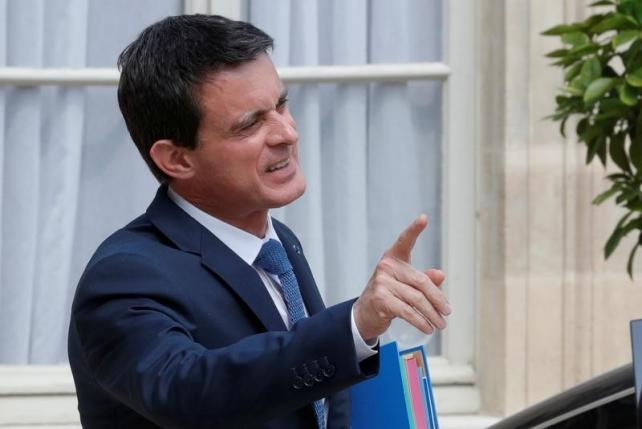 French Prime Minister Manuel Valls leaves the Elysee Palace in Paris