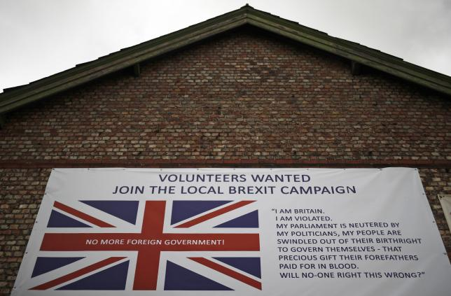 A banner encouraging people to support a local Brexit campaign hangs on the side of a building in Altrincham