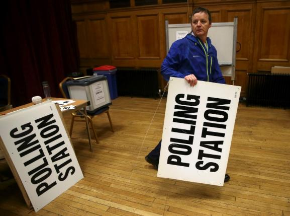 An electoral worker prepares a polling station for the Referendum on the European Union in north London