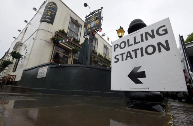 A sign points to a pub being used as a polling station for the Referendum on the European Union in west London