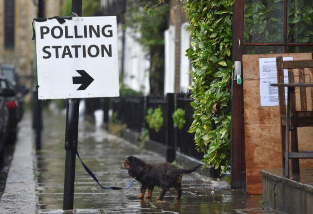 A dog waits for its owner outside a polling station for the Referendum on the European Union in west London