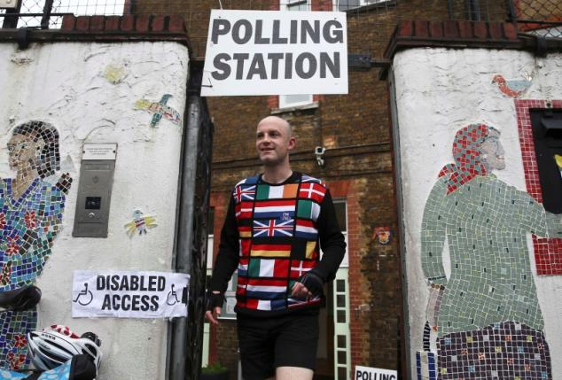 A man wearing a European themed cycling jersey leaves after voting at a polling station for the Referendum on the European Union in north London