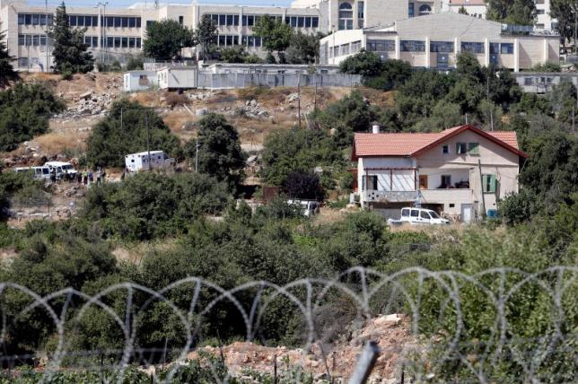 Israeli security forces gather near the house where a Palestinian fatally stabbed a 13-year-old girl inside her home in Kiryat Arba settlement, near the West Bank city of Hebron
