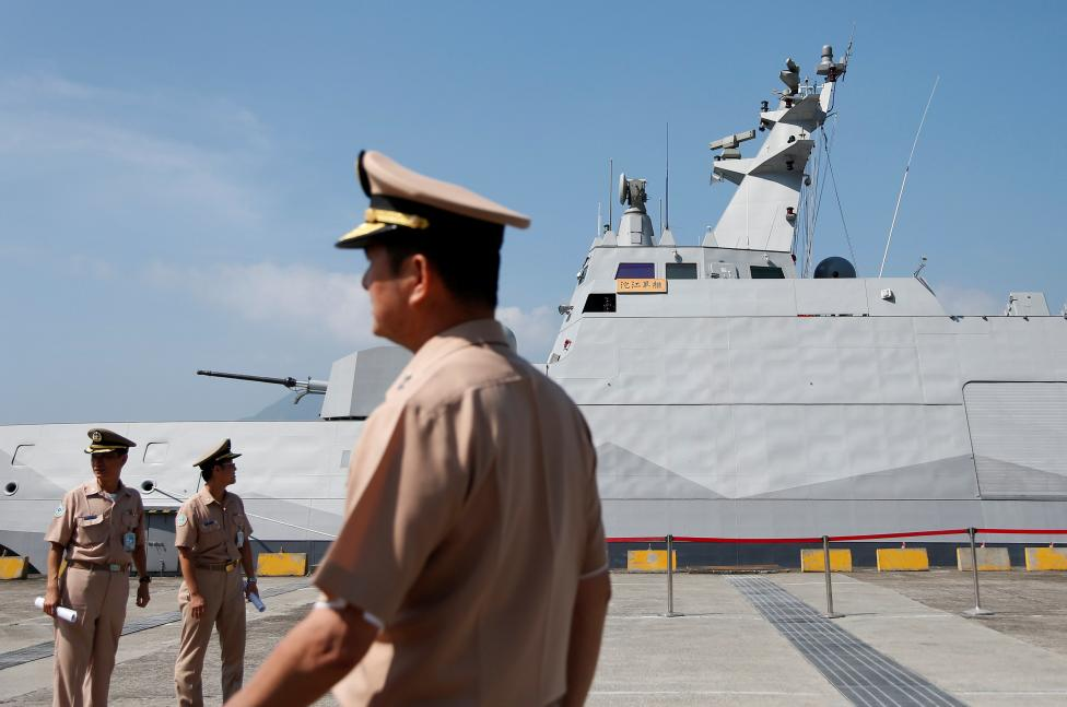 Taiwanese navy personnel are seen in front of the nation's first domestically built Tuo Jiang twin-hull corvette, at Suao Naval Base in Yilan, Taiwan