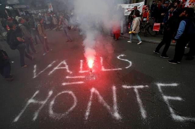 "The message ""Valls = shame"", in reference to French Prime Minister Manuel Valls, is seen on the road during a demonstration in Paris"