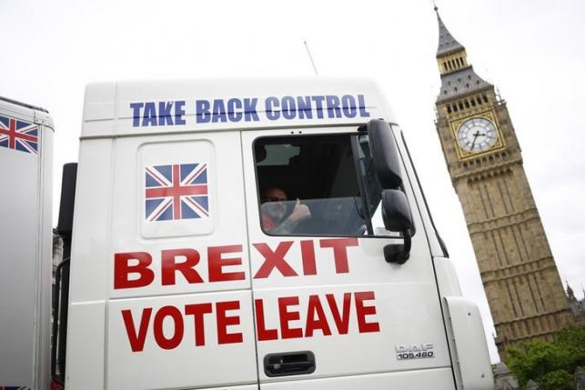 A truck is driven by Vote Leave supporters through Parliament Square in London