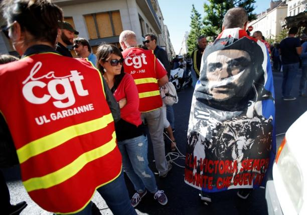 French CGT labour union employees march during a demonstration in Marseille as part of nationwide protests against plans to reform French labour laws