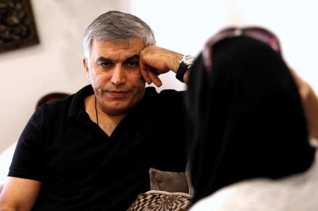 Human rights activists, Zainab al-Khawaja and Nabeel Rajab (L) talk during their meeting with activists after al-Khawaja's release from prison, Manama, Bahrain,