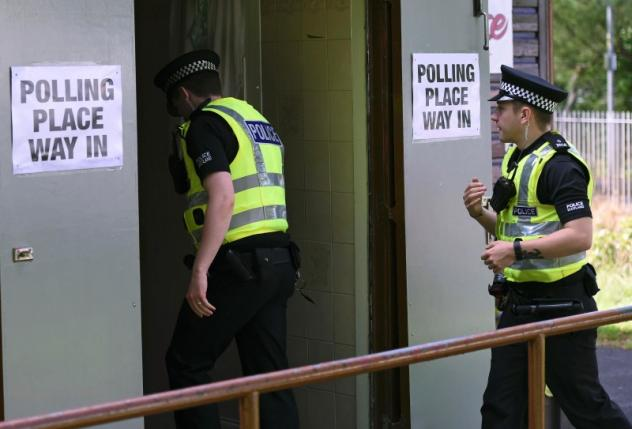 Police arrive to cast their votes in the EU referendum, at Broomhouse Community Hall in Glasgow