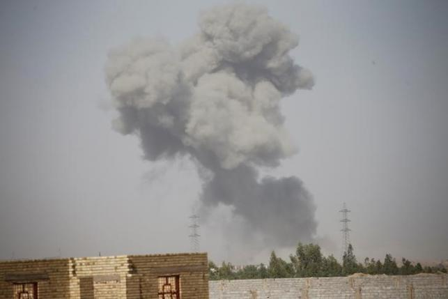 Smoke rises from clashes near Falluja