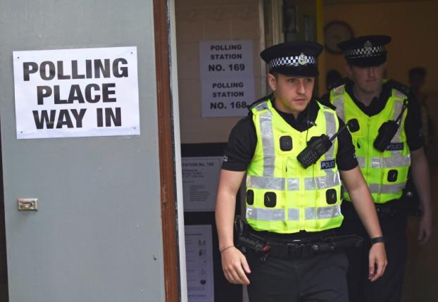 Police leave after to casting their votes in the EU referendum, at Broomhouse Community Hall in Glasgow
