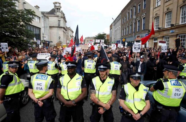 Police officers line up in front of a demonstration against Britain's decision to leave the European Union, in Southampton