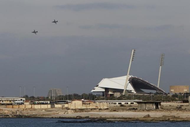 Russian warplanes fly in the sky over the Mediterranean coastal city of Latakia