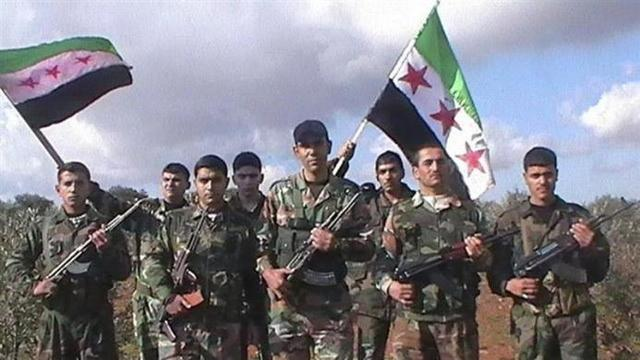 Syrian soldiers who defected to join the Free Syrian Army pose in the northern province of Idlib January 19, 2012. REUTERS/Handout (SYRIA - Tags: POLITICS CIVIL UNREST) FOR EDITORIAL USE ONLY. NOT FOR SALE FOR MARKETING OR ADVERTISING CAMPAIGNS. THIS IMAGE HAS BEEN SUPPLIED BY A THIRD PARTY. IT IS DISTRIBUTED, EXACTLY AS RECEIVED BY REUTERS, AS A SERVICE TO CLIENTS