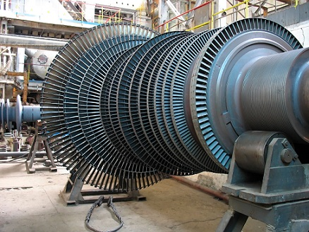 Power generator steam turbine during repair, machinery, pipes, tubes at a power plant